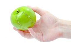 äpple - grön hand Royaltyfri Bild