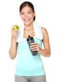äpple som äter den sunda livsstilkvinnan för kondition Arkivfoto