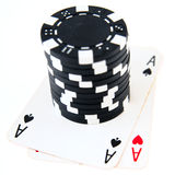 Ppocket aces and stack of black chips Stock Photo