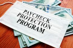PPP Paycheck Protection Program as SBA loan written on the mask.