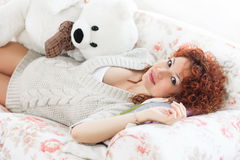 Ppregnant woman touching her belly while lying on a bed at h Royalty Free Stock Photography