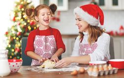 Ppy family bake christmas cookies royalty free stock photo