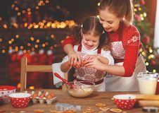 Happy family bake christmas cookies. Happy funny mother and child bake christmas cookies stock image