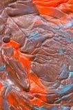 Präglad bakgrund av blandad turkos och apelsinen Med solreflexion royaltyfria foton