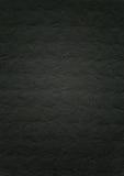 Präglad bakgrund för svartpapperstextur Royaltyfria Bilder