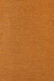 Präglad papp för brunt som är användbar som en bakgrund Royaltyfria Bilder