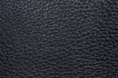 Präglad svart lädertextur, med ojämna former och åder Läder texturerar Royaltyfri Foto
