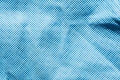 Präglad textur av tyg för syntetisk fiber, abstrakt bakgrund för närbild Royaltyfri Bild
