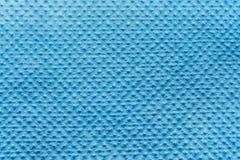Präglad textur av tyg för syntetisk fiber, abstrakt bakgrund för närbild Royaltyfria Bilder