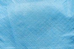 Präglad textur av tyg för syntetisk fiber, abstrakt bakgrund för närbild Arkivfoton