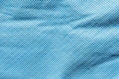 Präglad textur av tyg för syntetisk fiber, abstrakt bakgrund för närbild Royaltyfria Foton