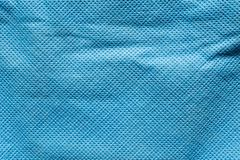 Präglad textur av tyg för syntetisk fiber, abstrakt bakgrund för närbild Arkivbilder