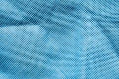 Präglad textur av tyg för syntetisk fiber, abstrakt bakgrund för närbild Royaltyfri Fotografi