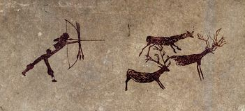 Prähistorischer Jäger - Höhleanstrichwiedergabe Stockfoto