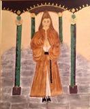 Präst helgon, helig man för tempel, med huva man som är from royaltyfri fotografi