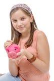Préadolescent avec une tirelire, sur le blanc photos libres de droits