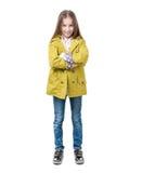 Préadolescent dans des vêtements sport, d'isolement sur le fond blanc image libre de droits