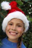 préadolescent s Santa de chapeau de fille Images libres de droits