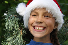 préadolescent s Santa de chapeau de fille Images stock
