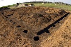 Préparation de la première pierre sur le chantier de construction, construction des cottages Photo libre de droits