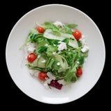Préparation de salade avec du fromage de chèvre Photos stock
