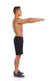 Préparation pour faire une posture accroupie Vue de côté Photo libre de droits