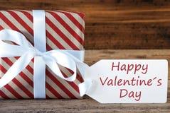 Présent avec le label, jour de valentines heureux des textes anglais Image stock