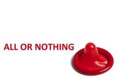 Préservatif rouge sur le fond blanc Photo libre de droits