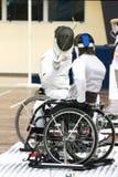 Présidence de roue clôturant pour les personnes handicapées photographie stock