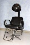 Présidence de sèche-cheveux au salon Images stock