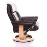 Présidence en cuir luxueuse de recliner, côté en fonction. Image stock