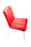 Présidence en cuir rouge d'isolement sur le blanc Photographie stock