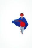Prétention fonctionnante masquée de garçon pour être super héros Photographie stock