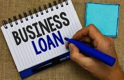 Prêt aux entreprises des textes d'écriture de Word Concept d'affaires pour l'homme de dette d'avances d'aide financière d'hypothè photos stock