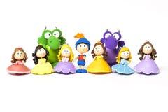 Príncipe, princesas y dragón en blanco Imagen de archivo