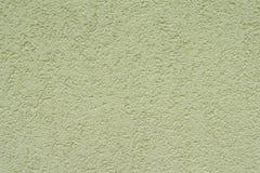 Próbka zewnętrzny tynk w baranka stylu, małych granulach, zakończeniu, oliwnym kolorze, fasadach domy, teksturze i tle, up, styl obrazy royalty free