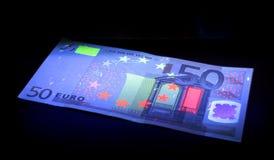 Prüfung des Geldes. Stockbild