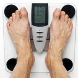 Prüfung seines Gewichts Stockfotos