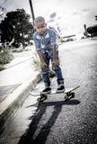 Prędkości łyżwiarki chłopiec Zdjęcia Royalty Free