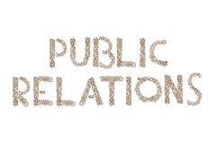PR written with small cubes. Public Relations written in letters formed with wooden cubes with letters isolated on white background Royalty Free Stock Photos