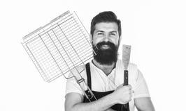 Prażaka i opieczenia jedzenie Brodaty modniś odzieży fartuch dla grilla Porady gotuje mięso Narzędzia dla piec mięso outdoors obraz royalty free