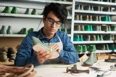 Praca cobbler obrazy stock