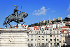 Praca da Figueira, Lisbon, Portugal. Statue of Joao I, with Sao Jorge castle in the background in Praca da Figueira, Lisbon Portugal Royalty Free Stock Image