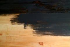 Praca w toku drewniany deska obraz z zmrok popielatą farbą fotografia stock