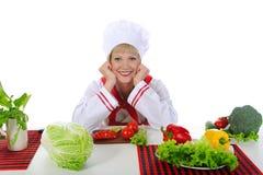 Prachtige chef-kok in de keuken. Stock Foto