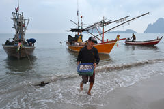 Prachuap Khiri Khan, Thailand. March 22: Fishermen unloading squid on the beach on March 22, 2014 in Stock Photos