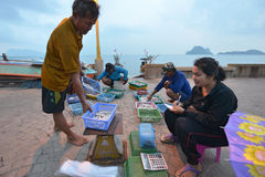 Prachuap Khiri Khan, Thailand. March 22: Fishermen unloading squid on the beach on March 22, 2014 in Royalty Free Stock Photography