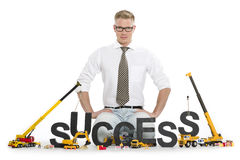Pracować na sukcesie: Biznesmena buildinging słowo. Obraz Stock