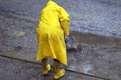 PRACOWAĆ W deszczu Zdjęcia Royalty Free
