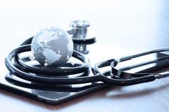 Pracowniany makro- tekstury kula ziemska i stetoskop Zdjęcia Stock